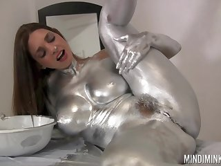 Nude beauty covers personally in mutate paint of a deviant solo