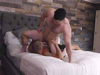 Brandon Anderson and Collin Simpson complete a workout alongside the bedroom