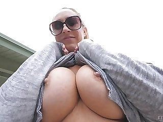Buxomy blond is displaying her phat knockers in front of the camera, to a naughty stranger