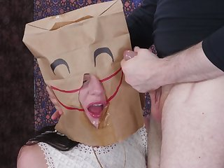 Kinky pervert in mask fucks mouth of naughty non-specific involving bag on head