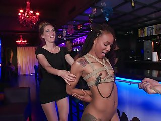 Mona Wales coupled with Nikki Darling fucked in a public BDSM orgy