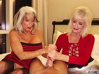 Mature sluts with fake tits pleasuring one unpremeditated baffle together